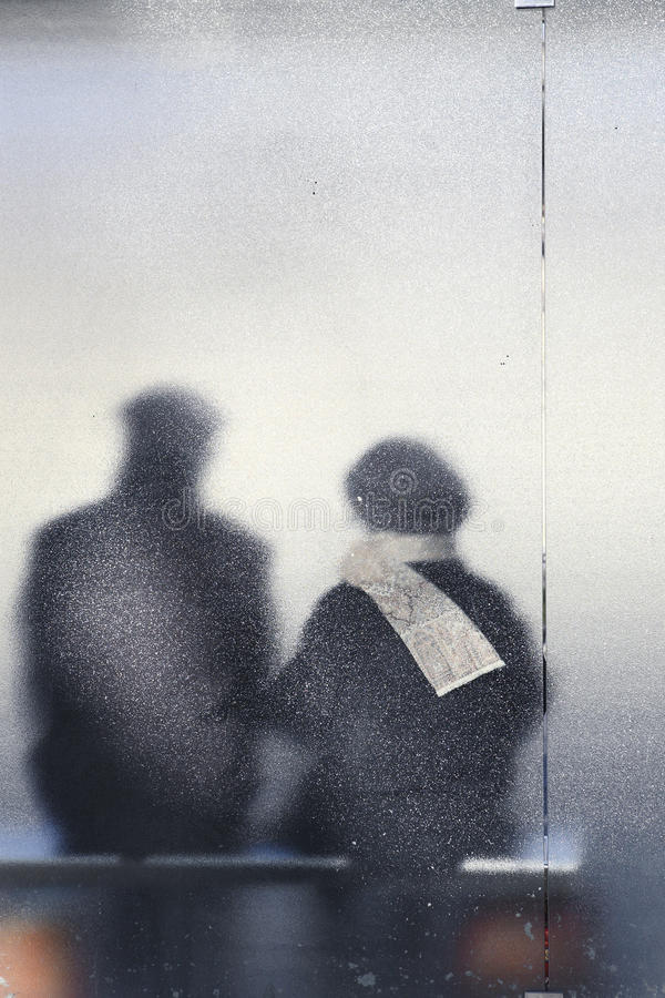 Old Couple Sitting In A Bus Stop Stock Images