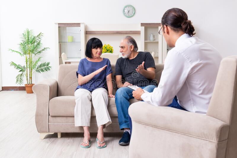 Old couple visiting psychiatrist doctor stock photos