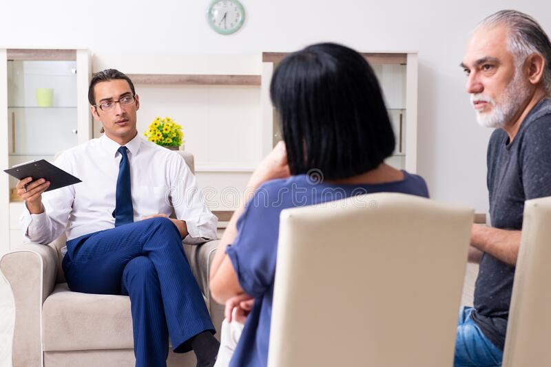 Old couple visiting psychiatrist doctor stock images