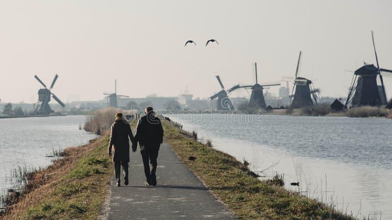 An Old Couple walking in Kinderdijk stock photo
