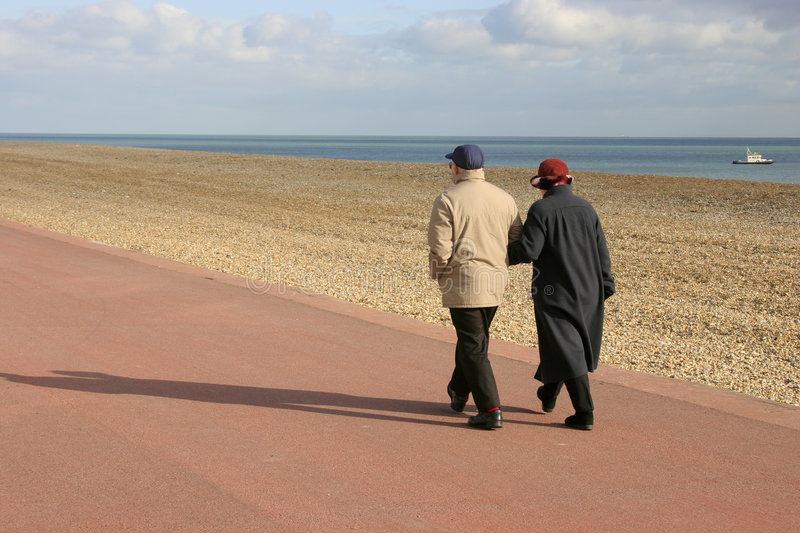 Old couple walking together royalty free stock photo