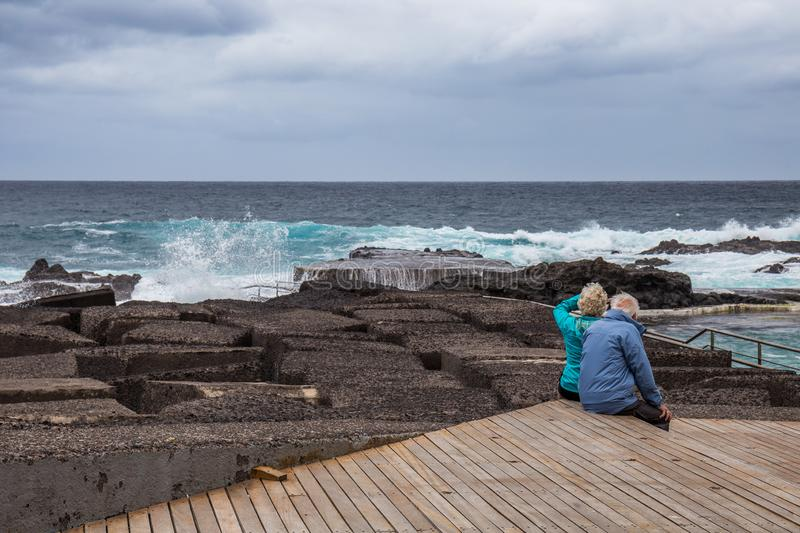 Old couple watching the ocean, Mesa del Mar, Tenerife, Canary Islands, Spain royalty free stock photography