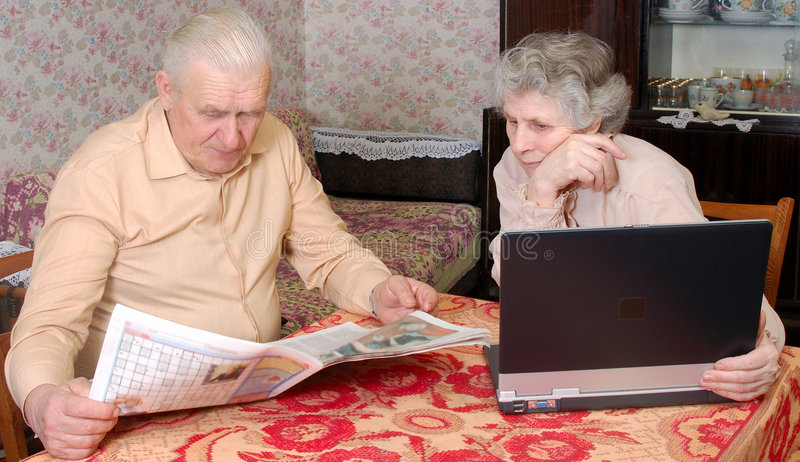 Old couplen reading hot news royalty free stock image