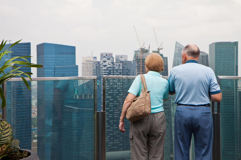 Old Couples Viewing Cityscape royalty free stock image