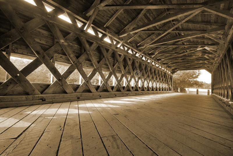 Old covered bridge with large oak boards stock photos