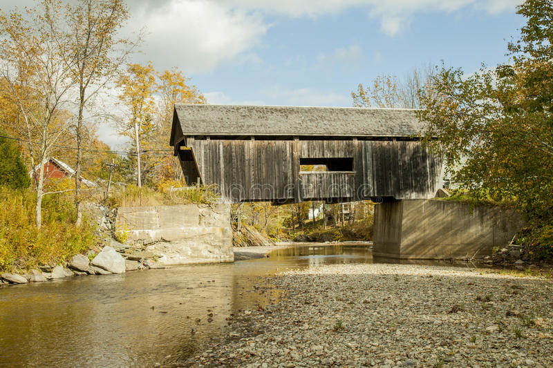 Old covered wooden bridge in Vermont, countryside royalty free stock photography