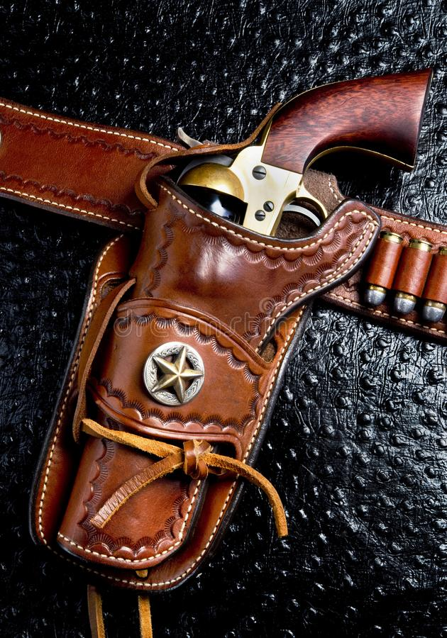Old Cowboy Gun. Old cowboy 45 pistol and leather tooled holster royalty free stock photo
