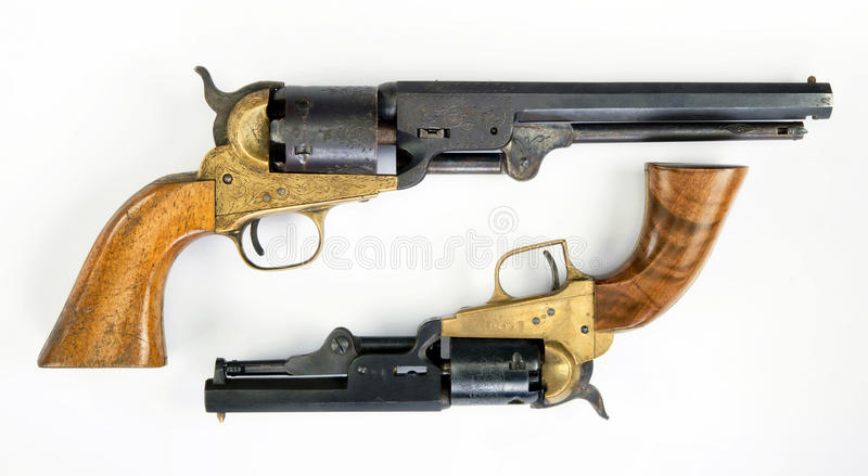 Old Cowboy Pistols. Two old western six shooter cowboy pistols royalty free stock images
