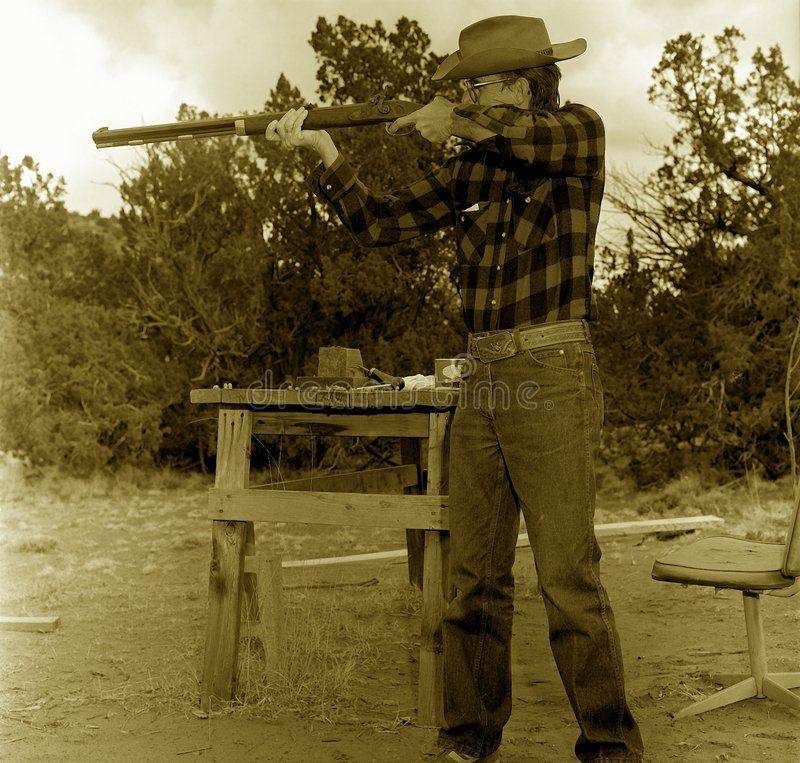 Old Cowboy Shooting Royalty Free Stock Photos