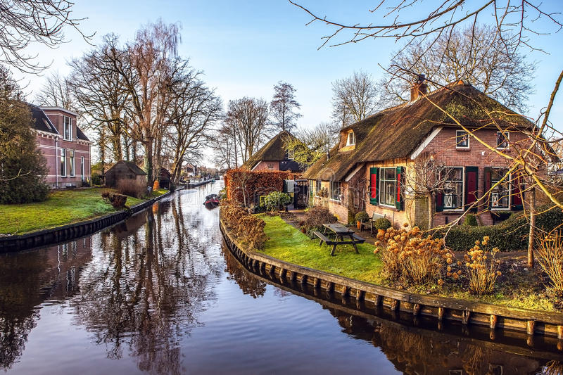 Old cozy house with thatched roof in Giethoorn, Netherlands. stock image
