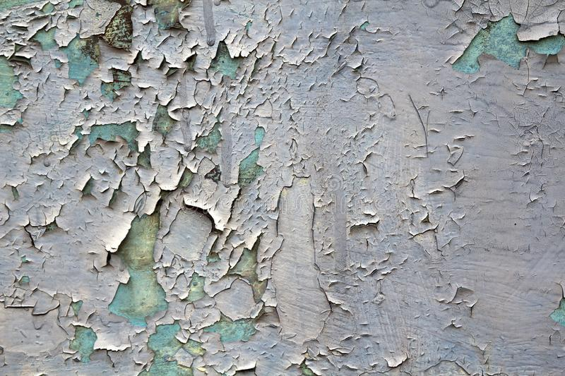 Old cracked abstract grunge vintage texture copy space background, retro pattern. White irregular spots paint peeling of light stock photo