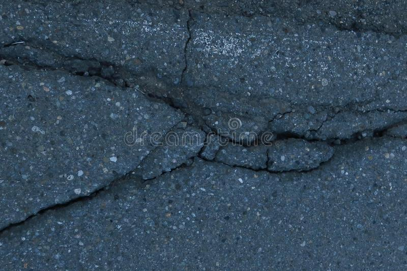 Old cracked asphalt surface. Background or texture stock photography