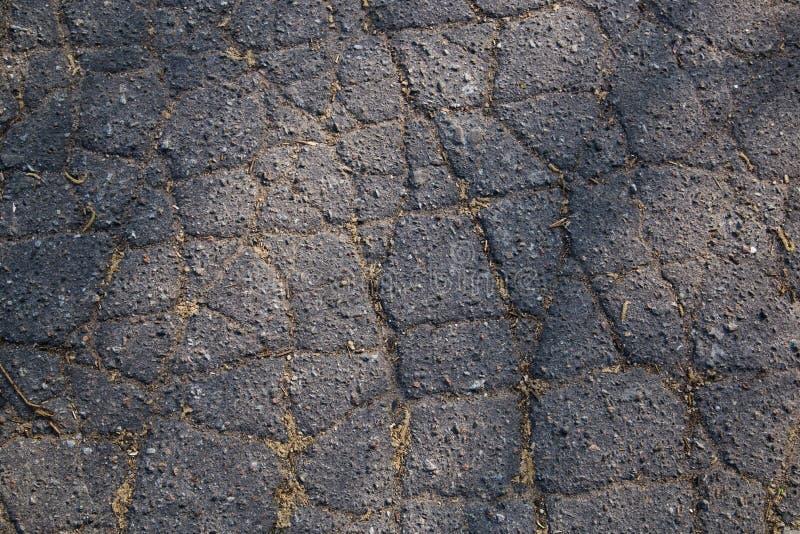 Old cracked asphalt texture or background stock image