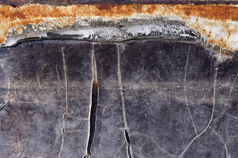 Old, cracked color metal background. With rust patches underneath stock image