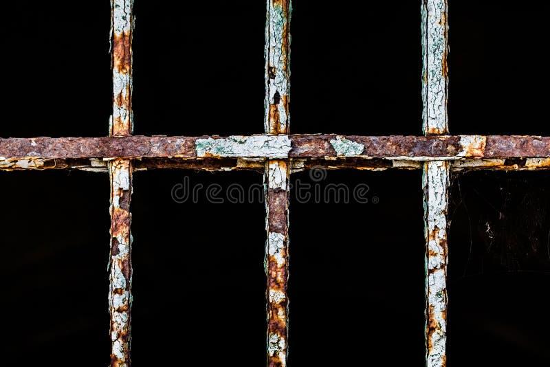 Old cracked iron metal rusty window bar stock photography