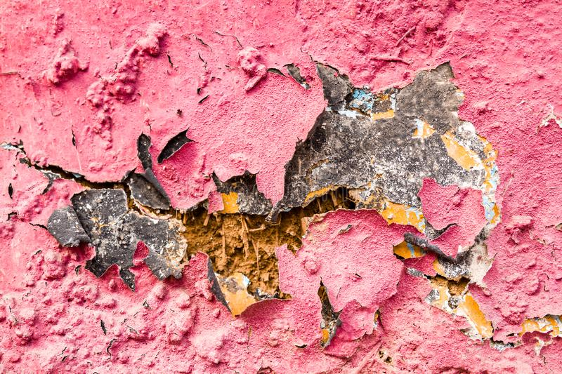 Old Cracked Mudbrick Wall with Peeled Pink Plaster stock photography