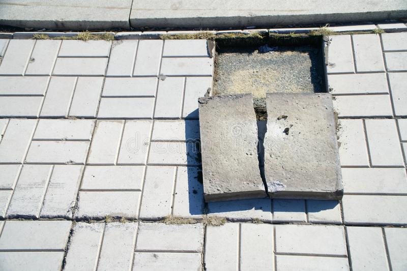 Old cracked pavement tiles, requiring dismantling and replacement. Chip. Old cracked pavement tiles, requiring dismantling and replacement. Urban economy. Chip royalty free stock photos