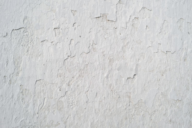 Old cracked wall covered grey plaster, background stock images