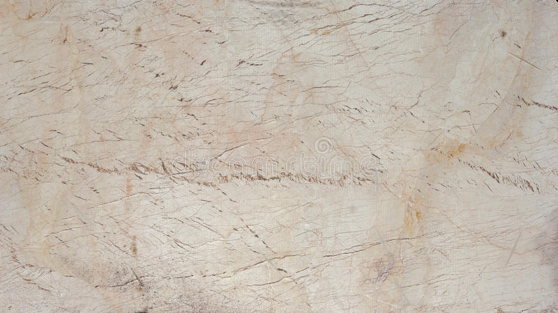 Old cracked wood panel painted white. And covered with fabric mesh. Textural background stock images