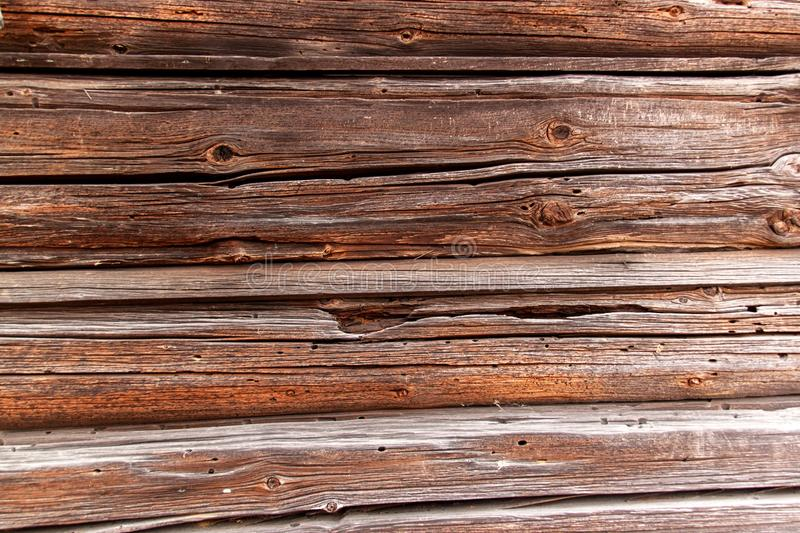 Old cracked wooden beams. Detail of a wooden wall. stock image