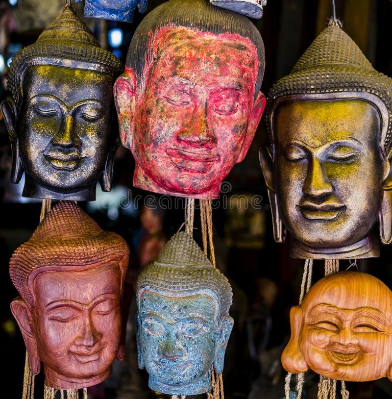 Carved Buddha head masks, Siem Reap, Cambodia royalty free stock photo