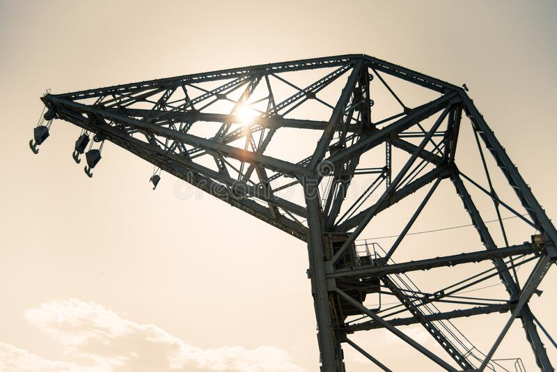 Old crane in the port of Valencia, Spain royalty free stock photos