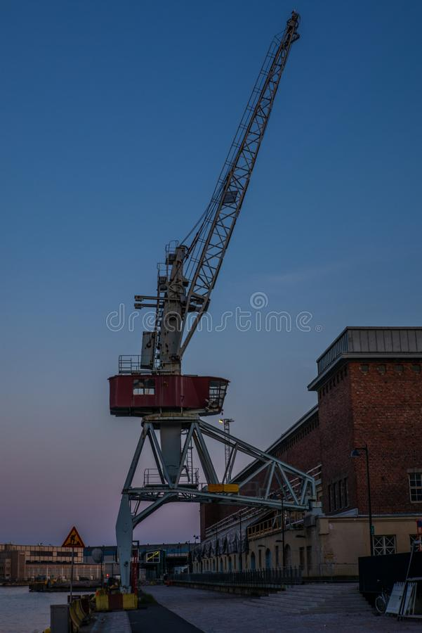 Old cranes, docks, warehouses and industrial buildings at the Helsinki port - 1 royalty free stock photo
