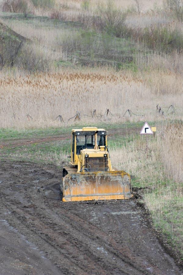Old crawler bulldozer in career royalty free stock image
