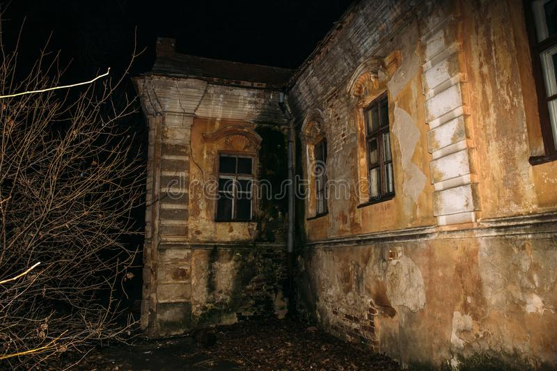 Old creepy abandoned haunted mansion, eerie house, horror atmosphere. Old creepy abandoned haunted mansion at night, eerie house, horror atmosphere stock photos