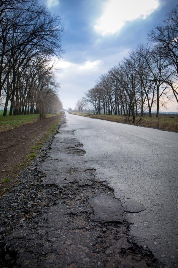 Old creepy asphalt road royalty free stock photography