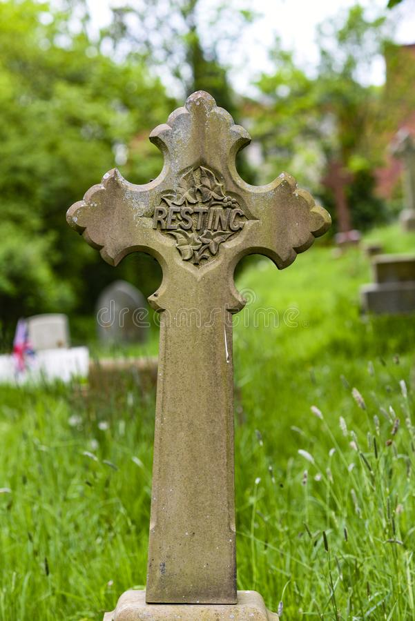 An old cross at a cemetery in England. stock images