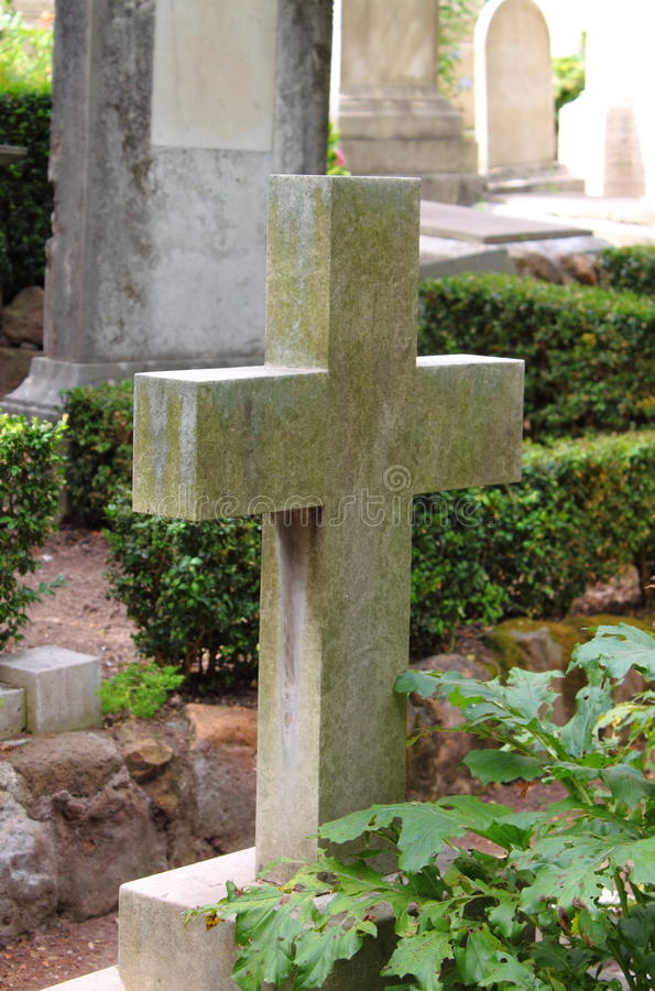 Old cross gravestone. In a graveyard royalty free stock photo