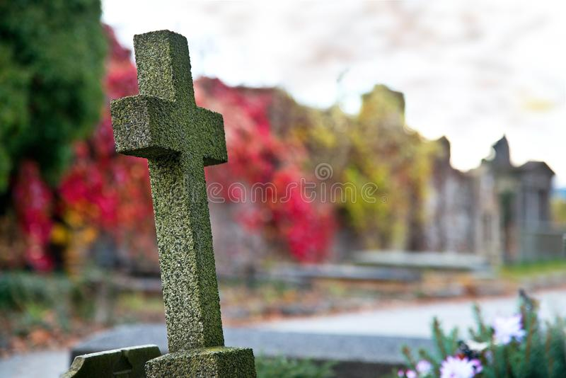 Old cross on graveyard stock photo