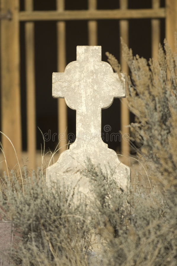 Old Crucifix. An old unidentified Gaelic crucifix adorns a neglected sanctuary at an abandoned New Mexico burial grounds royalty free stock photography