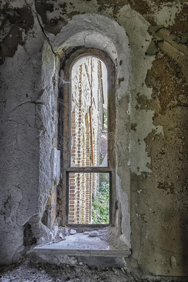 Old Crumbling Arched Church Window royalty free stock photography