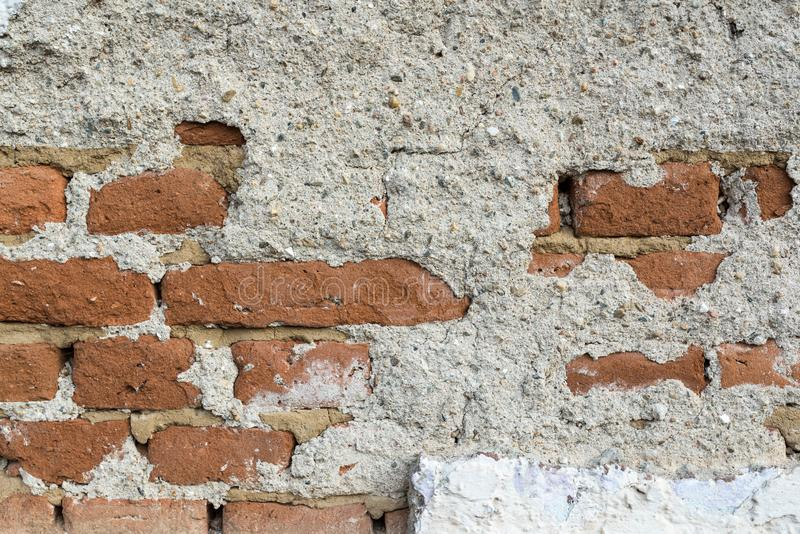Old crumbling brick wall on abandoned house close up shot royalty free stock images