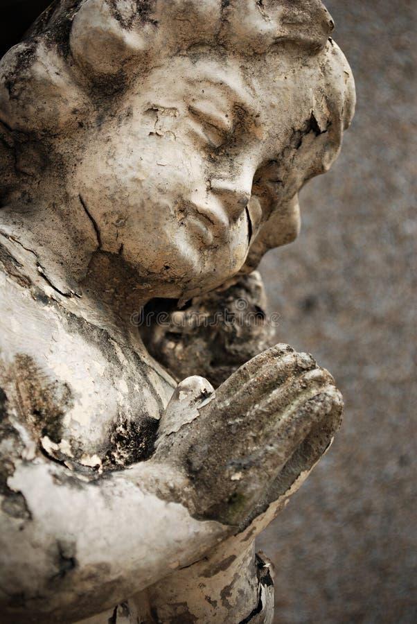 Old Crumbling Cherub Angel Statue stock photography