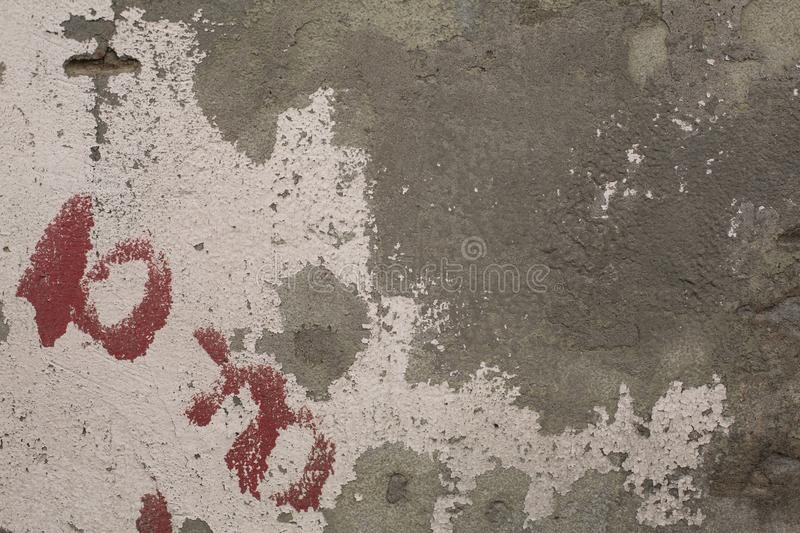 Old crumbling paint on gray plaster concrete wall texture stock photo