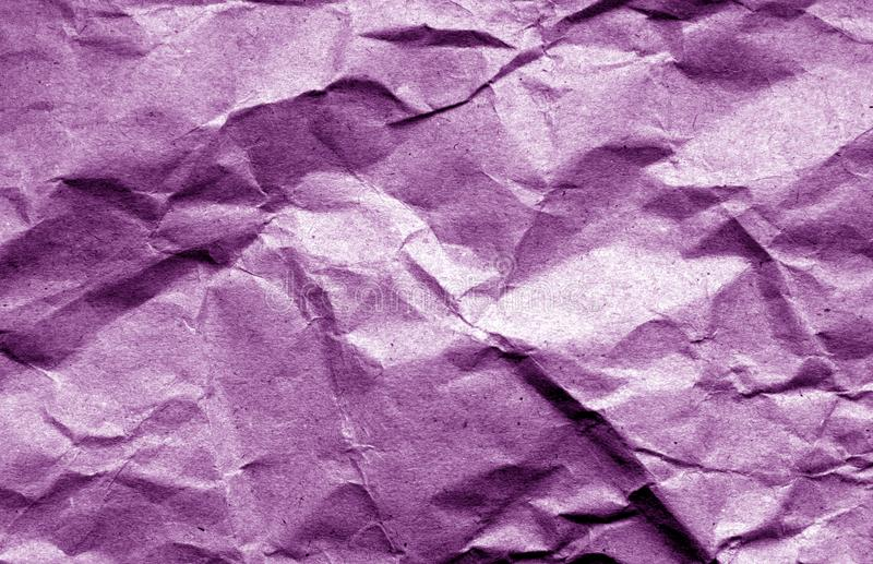 Old crumpled paper with wrinckles in purple color. stock image