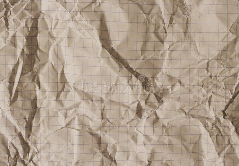 Old crumpled squared paper stock photo