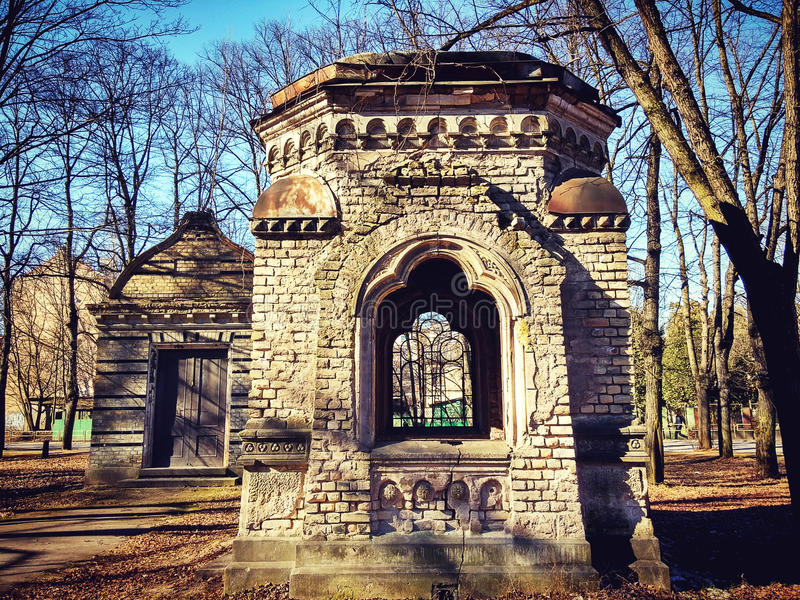 Old crypt at cemetery sunny day. Old Germany cemetery in Riga stock photography