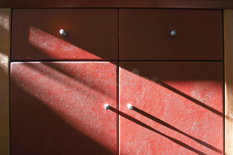 Old Cupboard with dust. In light and shadow stock images