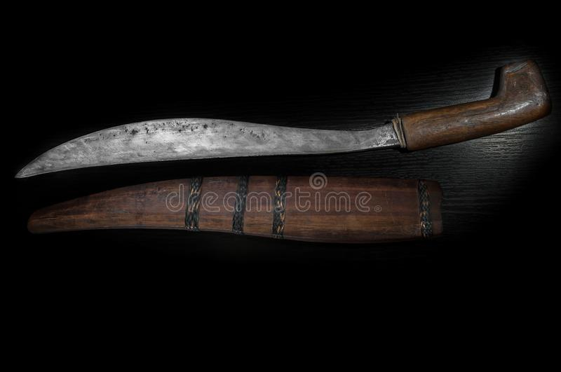 Old curve combat knife, scimitar, curved blade, wooden handle, black background. Old curve combat knife, scimitar, curved blade, wooden handle on black royalty free stock photo