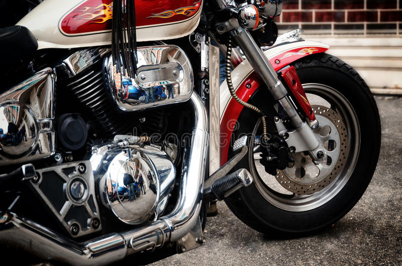 Old custom motorcycle. Vintage style custom motorcycle with flames decorations royalty free stock images