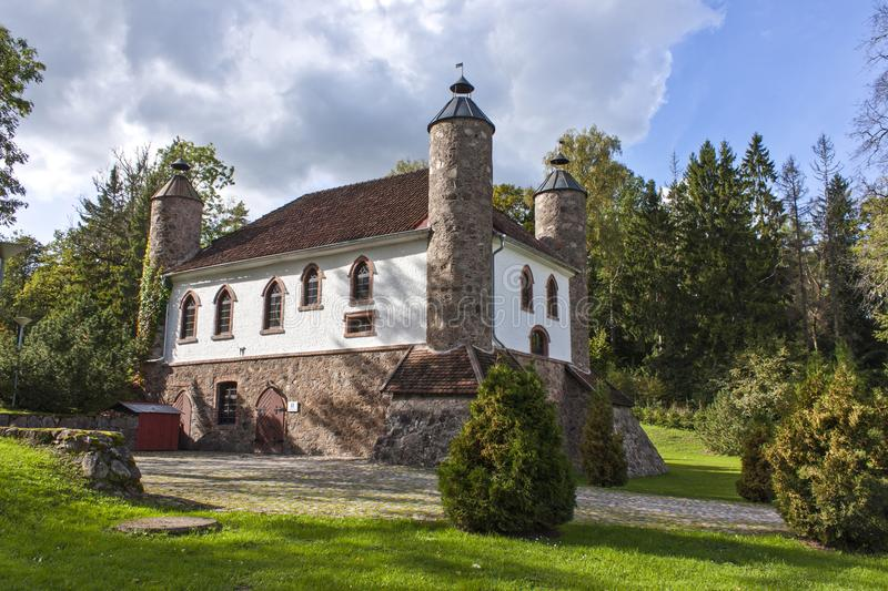 Old manor dairy house with towers in Heimtali royalty free stock image