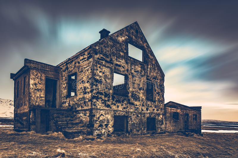 Old damaged house. Ruins of building on the wasteland, weathered and abandoned home in Iceland, Scandinavia, Europe royalty free stock photos