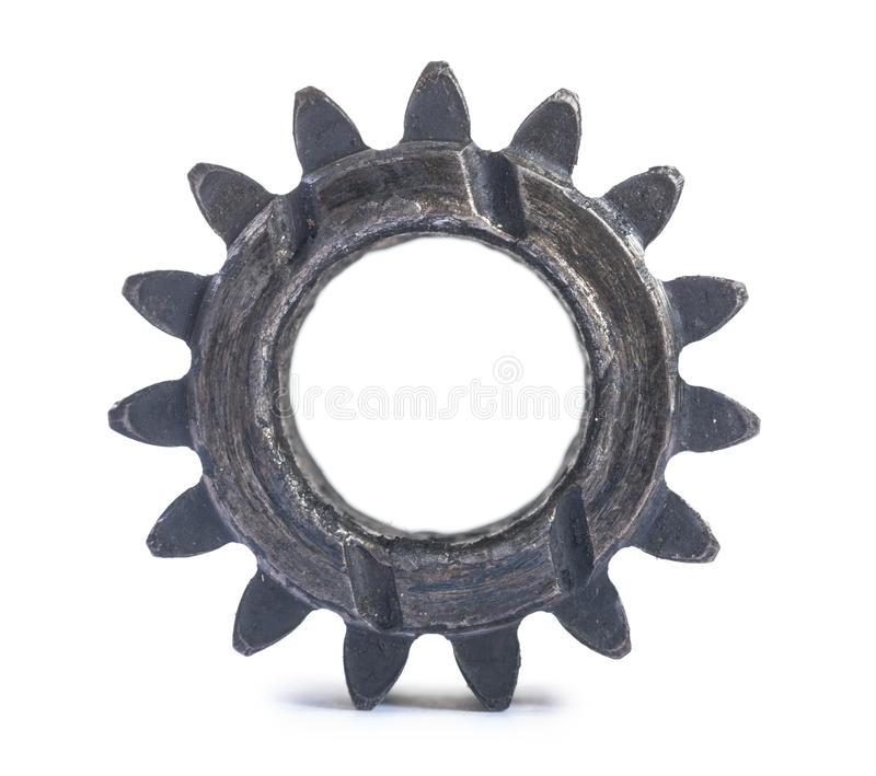 Old damaged and oiled gear wheel isolated on white background royalty free stock images