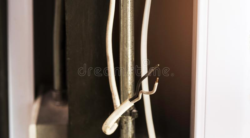 Old and damaged power cord. And dangerous if there is electrical leak stock image