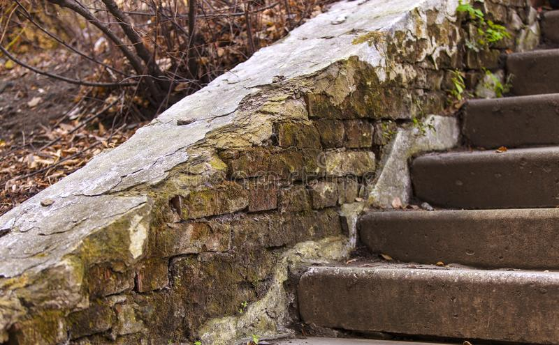 The old damaged stairs in abandoned house. stock images
