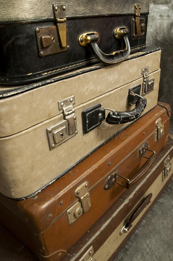 Vintage, aged suitcases on stack royalty free stock image